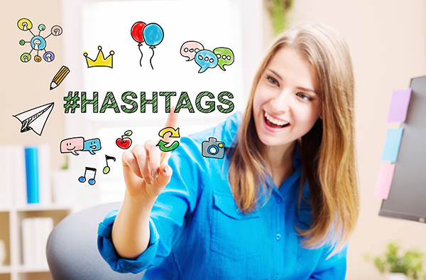 Woman using hashtags on social media